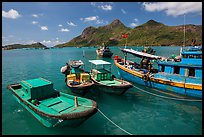 Fishing boats and Ba Island, Ben Dam. Con Dao Islands, Vietnam ( color)