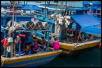 Sailors and families take lunch break at the back of boats, Ben Dam. Con Dao Islands, Vietnam ( color)