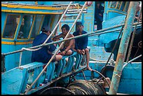 Fishermen relaxing on boats, Ben Dam. Con Dao Islands, Vietnam ( color)