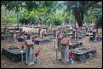 Graves memorializing independence fighters who died in jail. Con Dao Islands, Vietnam ( color)