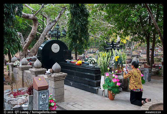 Woman pays respect to Vo Thi Sau grave. Con Dao Islands, Vietnam (color)