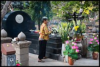 Woman offers incense at Vo Thi Sau grave. Con Dao Islands, Vietnam ( color)