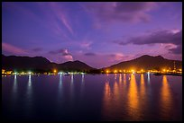 Lights of Con Son reflected in harbor at dawn. Con Dao Islands, Vietnam ( color)