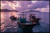 Fishing boats at sunrise, Con Son harbor. Con Dao Islands, Vietnam ( color)