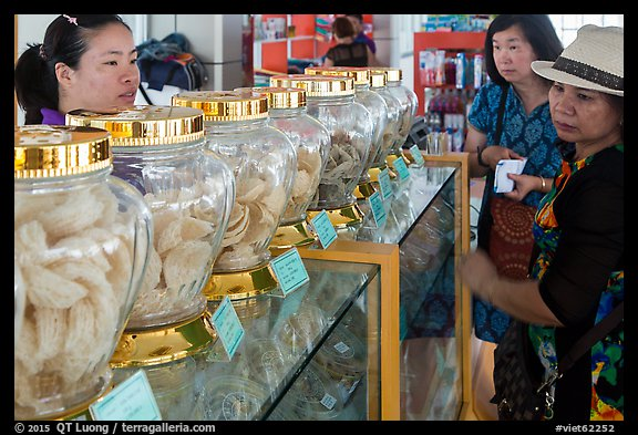 Women buying eddible birds nest. Con Dao Islands, Vietnam (color)