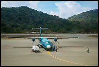 Turboprop plane and airport. Con Dao Islands, Vietnam ( color)