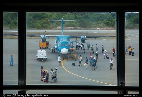Airport tarmac with just deplaned passengers. Con Dao Islands, Vietnam (color)