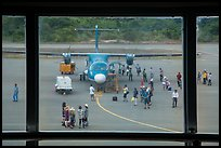 Airport tarmac with just deplaned passengers. Con Dao Islands, Vietnam ( color)