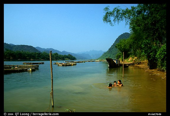 River with kids playing, Son Trach. Vietnam (color)
