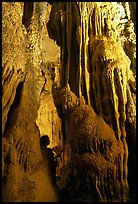 Tourist framed by cave formations, upper cave, Phong Nha Cave. Vietnam (color)