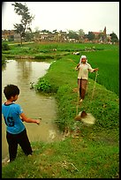Field irrigation with a swinging bucket. Vietnam (color)
