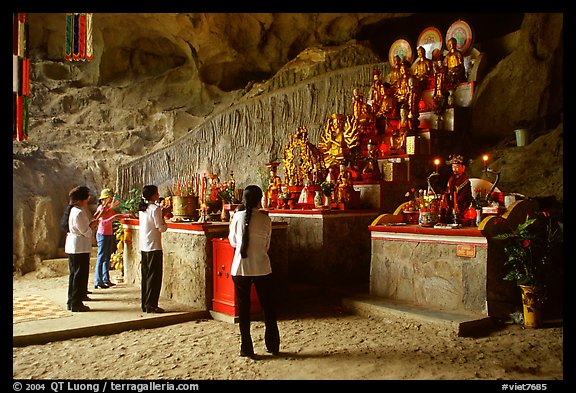 Women praying at the altar at the entrance of Tan Thanh Cave. Lang Son, Northest Vietnam (color)