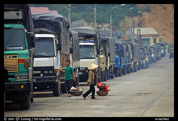Trucks waiting to cross the border into China at Dong Dang. Lang Son, Northest Vietnam (color)