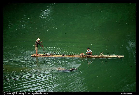 Crossing the Ky Cung  River on a narrow dugout boat. Northest Vietnam (color)