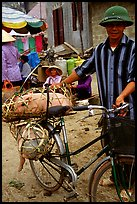 Man with a newly bought pig loaded on his bicycle, That Khe market. Northest Vietnam (color)