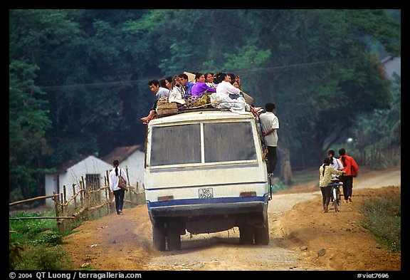 Passengers sitting on top of an overloaded bus. Northest Vietnam (color)