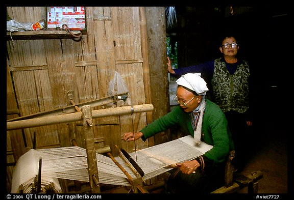 Elderly woman weaving in her home. Northeast Vietnam