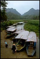 Boats waiting for villagers at a market. Northeast Vietnam (color)