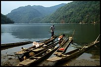 Dugout boats on the shore of Ba Be Lake. Northeast Vietnam (color)
