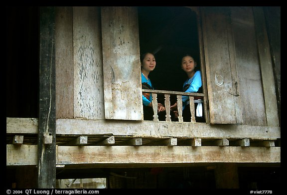 Two thai women at the window of their stilt house, Ban Lac village. Northwest Vietnam (color)