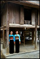 Two thai women standing in front of their stilt house, Ban Lac village. Northwest Vietnam ( color)