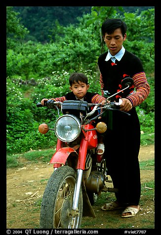 Hmong motorcyclist and boy, Xa Linh. Northwest Vietnam (color)