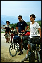 Western adventure travellers on mountain bikes, near Tam Duong. Northwest Vietnam (color)