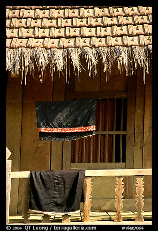Detail of hut with montagnard dress being dried, between Tuan Giao and Lai Chau. Northwest Vietnam (color)
