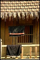 Detail of hut with montagnard dress being dried, between Tuan Giao and Lai Chau. Northwest Vietnam ( color)