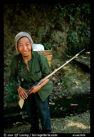 Hunter holding an old rifle, near Lai Chau. Northwest Vietnam (color)
