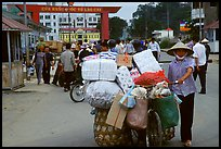 Woman pushing a bicycle loaded with cheap goods at the Lao Cai border crossing. Vietnam ( color)