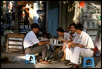 Enjoying a cafe on the streets, sitting on the typical tiny chairs. Ho Chi Minh City, Vietnam
