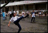 Students playing foot-only volley-ball in a school courtyard. Ho Chi Minh City, Vietnam