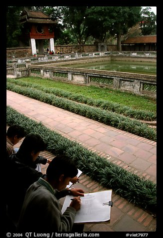 Art students drawing in the Temple of the Litterature. Hanoi, Vietnam (color)