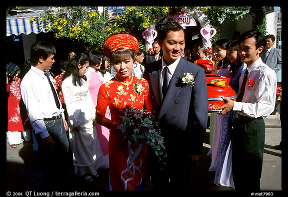 Newly-wed couple exit the bride's home. Ho Chi Minh City, Vietnam (color)
