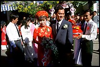 Newly-wed couple exit the bride's home. Ho Chi Minh City, Vietnam ( color)