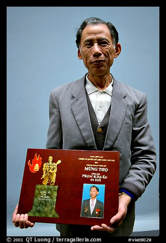 Former militia member with certificate of heroism, Hanoi. Vietnam (color)