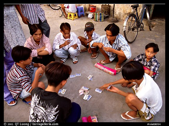 Children playing cards. Ho Chi Minh City, Vietnam (color)