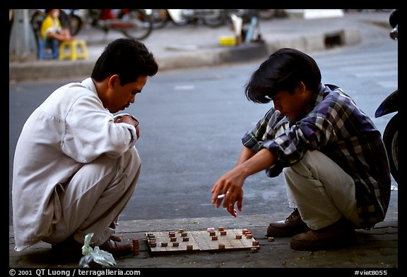 Chinese Chess game. Vietnamese people can sit on their heels for hours. Ho Chi Minh City, Vietnam (color)