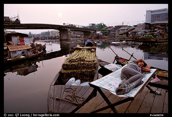 Sleeping out for the fresh air. Morning near the Saigon arroyo. Cholon, Ho Chi Minh City, Vietnam (color)