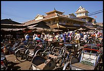 Cyclos wait outside the Bin Tay market in Cholon, district 6. Cholon, Ho Chi Minh City, Vietnam