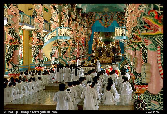 The noon ceremony, attended by priests inside the great Cao Dai temple. Tay Ninh, Vietnam