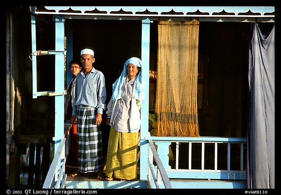 Muslem family outside stilt house in Cham minority village. Chau Doc, Vietnam (color)