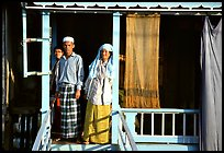 Muslem family outside stilt house in Cham minority village. Chau Doc, Vietnam ( color)
