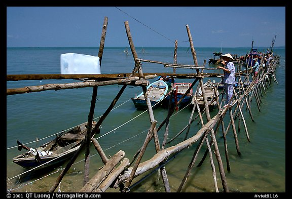 An ice block being loaded into a fishing boat. Vung Tau, Vietnam (color)