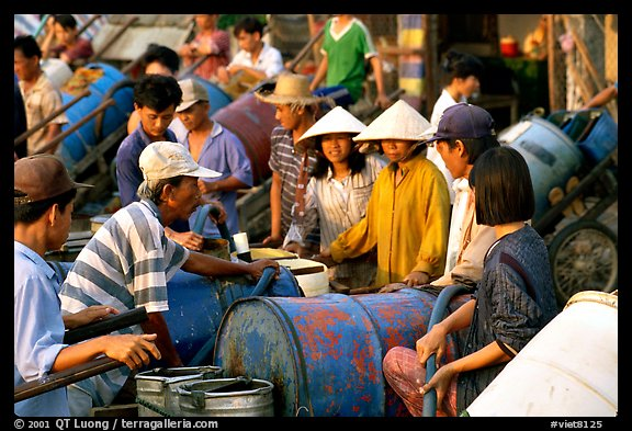 Filling up water tanks for the day. Ha Tien, Vietnam (color)