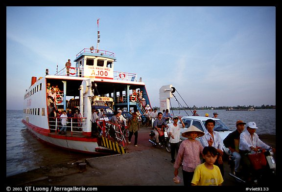 Disembarking from a ferry on one of the many arms of the Mekong. My Tho, Vietnam (color)