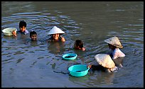 Collecting clams, near Long Xuyen. Mekong Delta, Vietnam (color)
