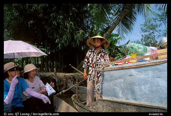 Buying groceries on the Phong Dien floating market. Can Tho, Vietnam (color)