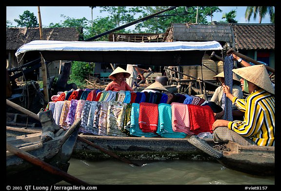 Garnments for sale on the Phong Dien floating market. Can Tho, Vietnam (color)